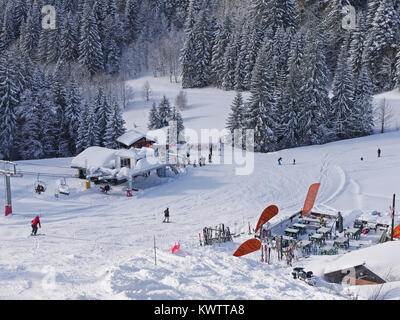 Chairlift on the back side of Mont Chery in the ski resort of Les Gets, France - Stock Photo