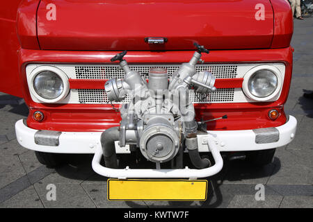 Old vintage fire truck with pumps and pipes - Stock Photo