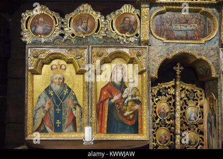 Traditional Carpathian icons in the wooden carved iconostasis in All Saints Church (Kostel Všech svatých) in the - Stock Photo