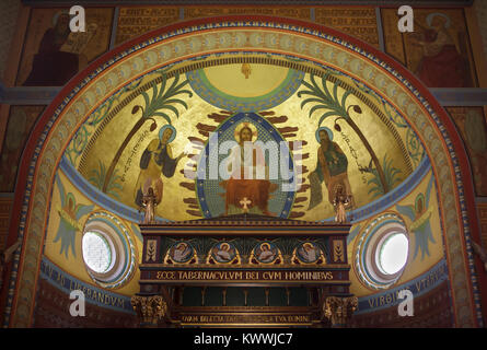 Jesus Christ surrounded Saints Peter and Paul depicted in the mural in the presbytery of the Church of Our Lady - Stock Photo