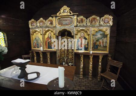 Traditional Carpathian wooden carved iconostasis in All Saints Church (Kostel Všech svatých) in the village of Dobříkov - Stock Photo