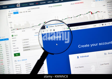 MONTREAL, CANADA - DECEMBER 23, 2017 : Coinbase cryptocurrency exchange website under magnifying glass - Stock Photo