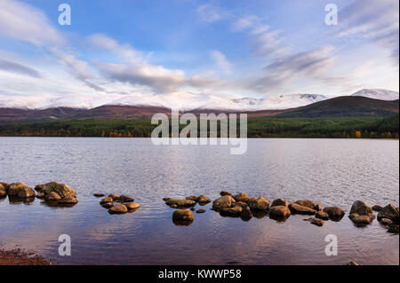 Panoramic view of Loch Morlich and the Cairngorms. This freshwater lake is in Badenoch and Strathspey area of Highland, - Stock Photo
