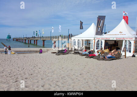 People relaxiing at the beach, pier of Zingst, Fishland, Mecklenburg-Western Pomerania, Baltic sea, Germany, Europe - Stock Photo