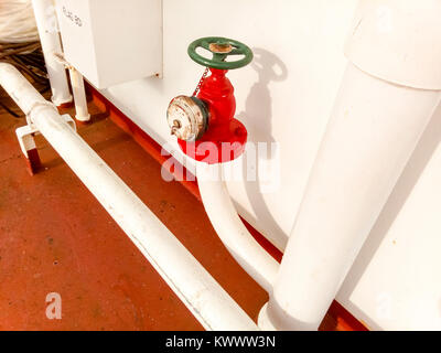 Manual shut-off valve of the outlet pipe of the water supply line of the fire-fighting system. - Stock Photo