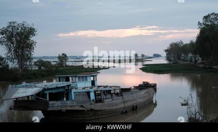 Abandoned Boat on the Borei Shoreline Takeo, Cambodia Decrepit Third World Underdeveloped Country South East Asia - Stock Photo