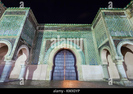 The Bab Mansour in Meknes, Morocco at night. Gate Bab Mansour Gate named after the architect, El-Mansour. Gate Bab - Stock Photo