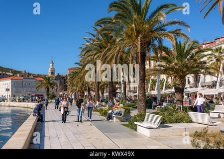 Tourists and locals enjoying Riva promenade, Split, Croatia - Stock Photo