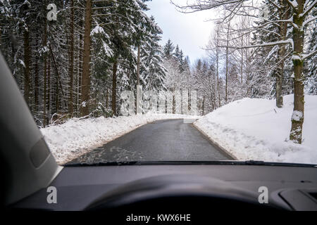 Inside a car on a snowy road in the Harz mountains - Stock Photo