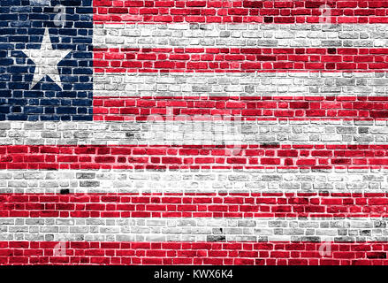 Flag of Liberia painted on brick wall, background texture - Stock Photo