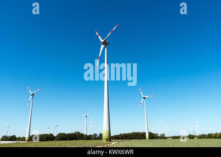 Wind power in the fields seen in rural Germany - Stock Photo