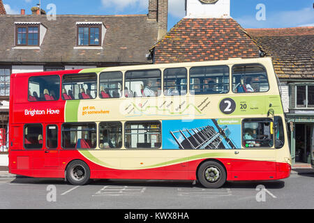 Local double-decker bus at bus stop, High Street, Steyning, West Sussex, England, United Kingdom - Stock Photo