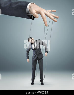 conceptual photo of a boss pulling the strings - Stock Photo