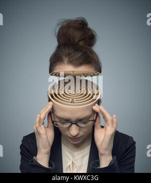 Conceptual image of a labyrinth in the woman's brain - Stock Photo