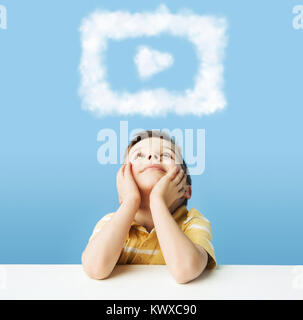 Little man dreaming about cloudlet shapes - Stock Photo