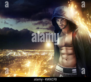 Conceptual photograph of a hooded muscular strongman - Stock Photo