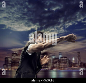 Successful man over the town background - Stock Photo