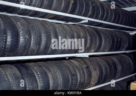 Group of new tires for sale at tire store - Stock Photo