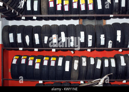 new tires for sale at tire store - Stock Photo