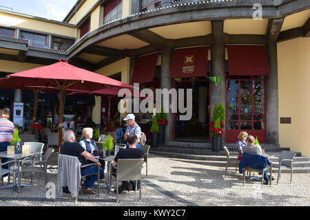 People seated at tables outside the Mercado Taps Bar, Mercado dos Lavradores, Funchal, Madeira, Portugal - Stock Photo