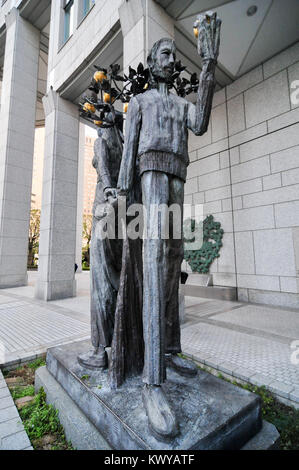 Adam and Eve sculpture by Munehiro Ikeda by the Tokyo Metropolitan Government Building in Tokyo, Japan. - Stock Photo