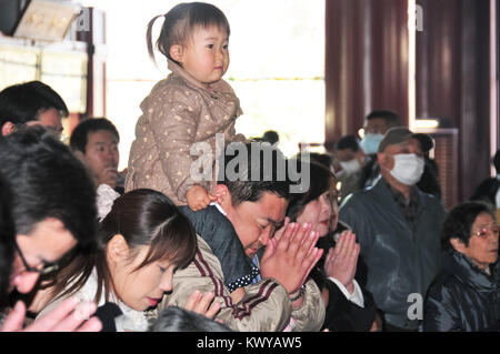 Tokyo, Japan - March 15, 2009: People praying at the Shinto Asakusa Temple in Tokyo, Japan. - Stock Photo
