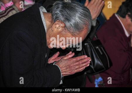 Tokyo, Japan - March 15, 2009: Old man praying at the Shinto Asakusa Temple in Tokyo, Japan. - Stock Photo