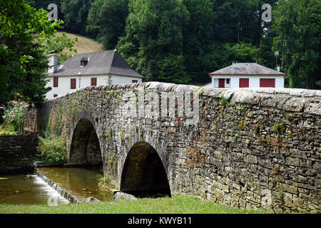 ORDIARP, FRANCE - CIRCA JULY 2015 Old stone bridge and houses - Stock Photo