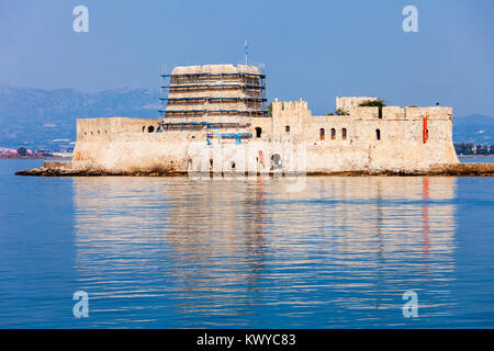 Bourtzi is a water castle located in the middle of Nafplio harbour. Nafplio is a seaport town in the Peloponnese - Stock Photo