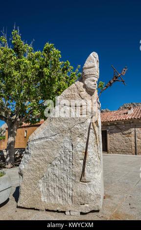 Pope John Paul II granite statue in village of San Pantaleo, near Arzachena and Costa Smeralda, Sassari province, - Stock Photo