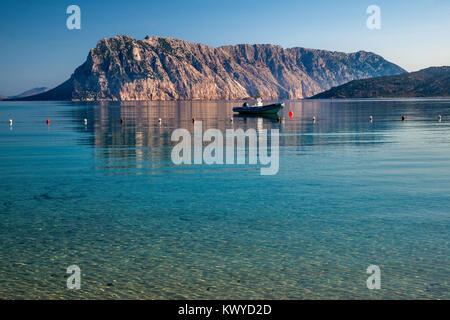 Isola Tavolara, view from Spiaggia di Cala Suaraccia (Le Farfalle), Mediterranean Sea beach near village of Monte - Stock Photo