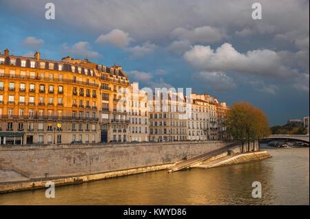 Paris quai Seine, view at sunset across the River Seine of apartments along the Quai d'Orleans on the Ile St-Louis, - Stock Photo