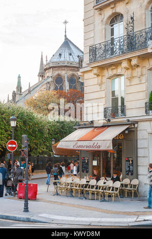 Paris cafe, a street corner cafe on the Ile de la Cite, Paris, with Notre Dame cathedral in the background, France. - Stock Photo