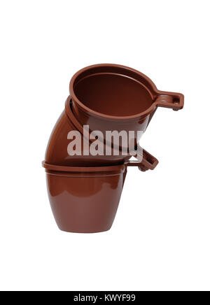 Stack of three brown plastic cups isolated on white background with clipping path - Stock Photo