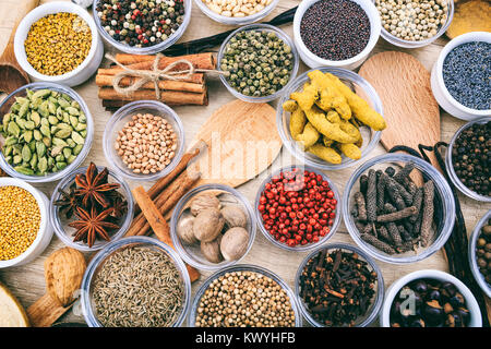 Composition of various spices on a wooden surface - Stock Photo