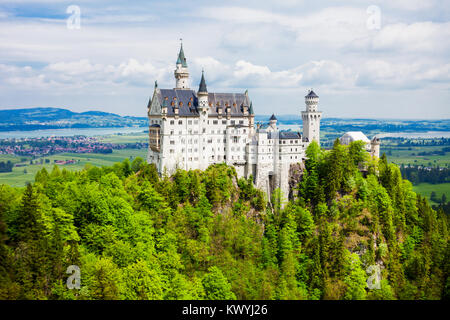 Schloss Neuschwanstein Castle or New Swanstone Castle is a Romanesque Revival palace in Hohenschwangau village near - Stock Photo