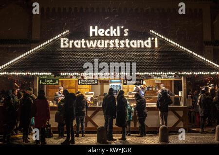 MUNICH, GERMANY - DECEMBER 17, 2017: Sausage hut stand (Bratwurststand) on Munich Christmas market (Christkindlmarkt) - Stock Photo
