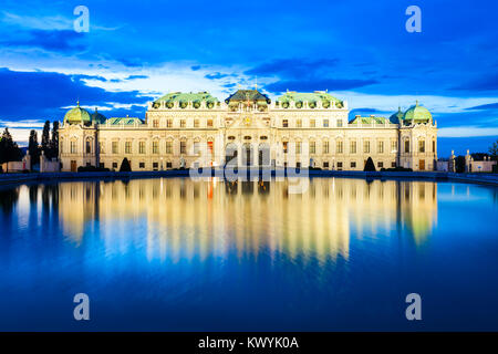 The Belvedere Palace is a historic building complex in Vienna, Austria at sunset. Belvedere was built as a summer - Stock Photo