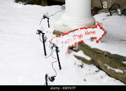 Santa stop here sign in the snow. - Stock Photo