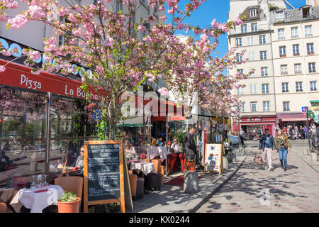 PARIS, FRANCE - APRIL 18 2016: A row of restaurants in Latin Quarter at Spring. Once a student neighbourhood, now - Stock Photo