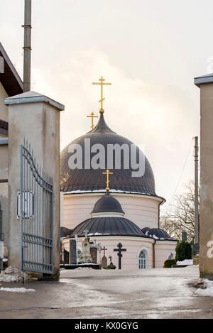 Vilnius, Lithuania - December 24, 2017: Cars parked in the streetRussian orthodox church in winter - Stock Photo