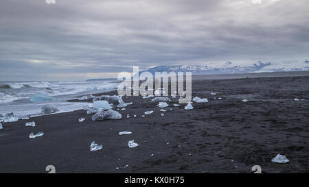 Lumps of ice washed up on Diamond Beach at the Glacier Lagoon Jökulsárlón on the edge of Vatnajökull National Park - Stock Photo