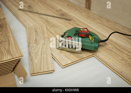 For cutting laminate using an electric jigsaw - Stock Photo
