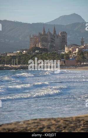PALMA DE MALLORCA, SPAIN - JANUARY 4, 2018: Cathedral La Seu and windy ocean on a sunny winter afternoon on January - Stock Photo
