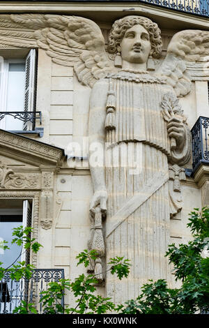 France, Paris (75), Angel decorating the side of an apartment building in the 3rd arrondissement. - Stock Photo