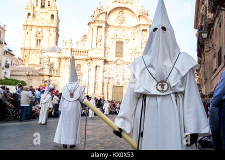 During the Semana Santa, Holy Week ceremonies, penitents parade through the streets of Murcia in Spain - Stock Photo