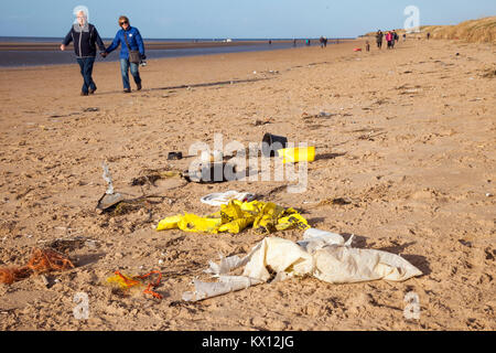 Crosby, Merseyside UK. Dumped drinks cups, plastic cutlery, straws, plastic bottles, lids stirrers, buckets, polythene, - Stock Photo