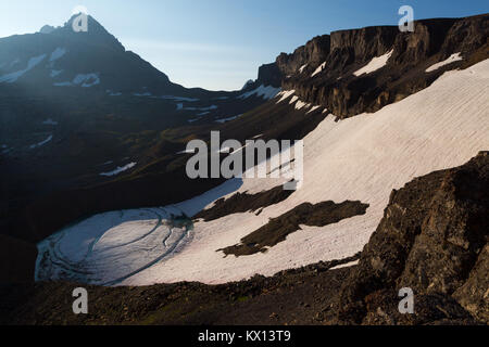 The South Teton rising above Schoolroom Glacier at the top of the South Fork of Cascade Canyon in the Teton Mountains. - Stock Photo