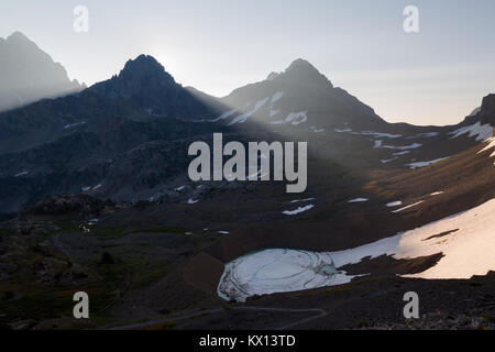The Grand, Middle, and South Teton peaks rising above Schoolroom Glacier in the South Fork of Cascade Canyon at - Stock Photo