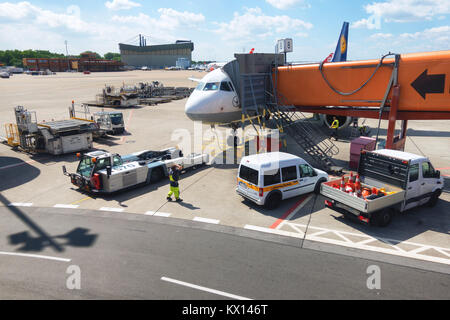 Berlin, Germany - May 31 2017: Airport operations at Berlin Tegel airport preparing a Lufthansa passenger jet for - Stock Photo